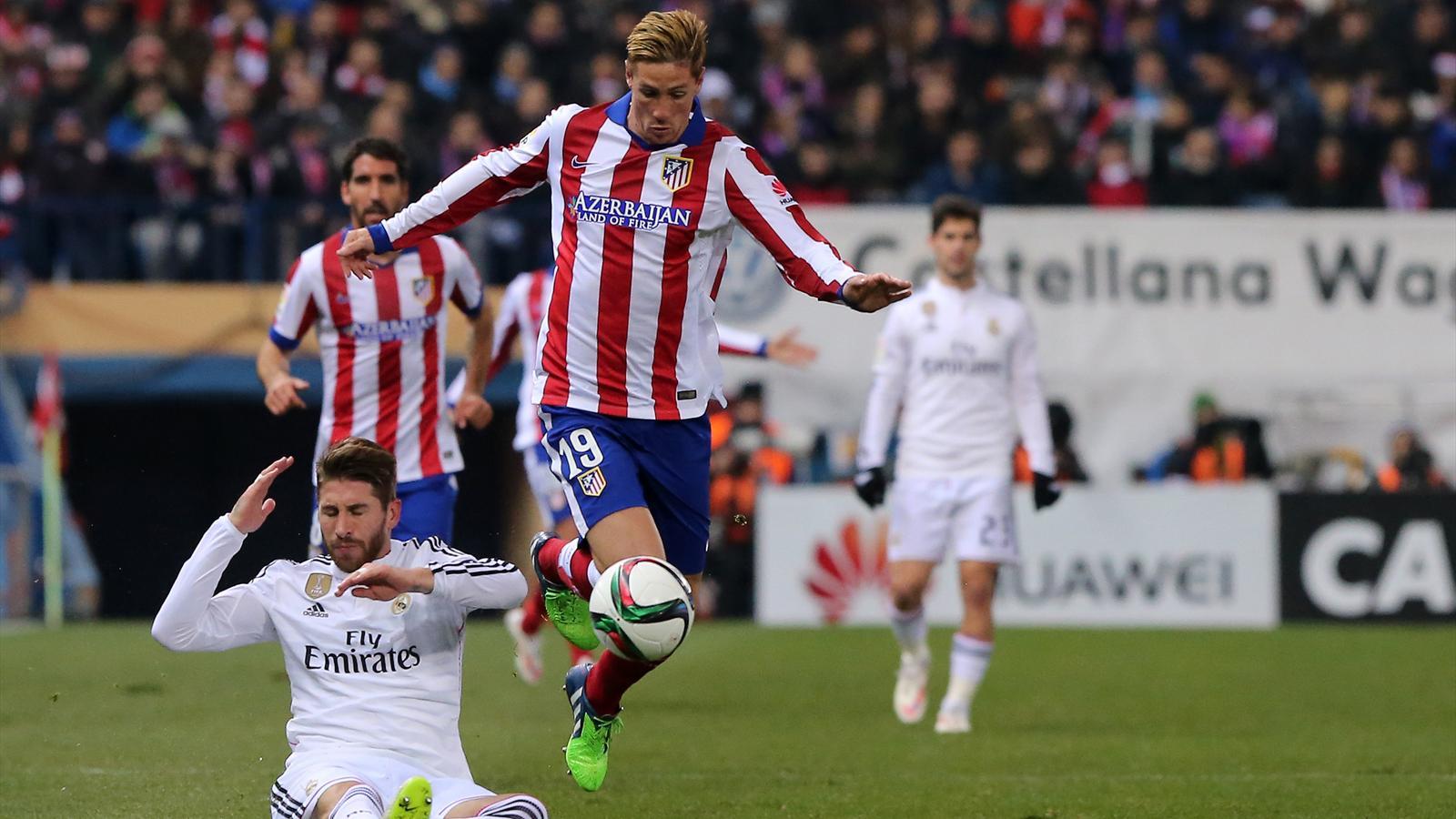 Fernando Torres y Sergio Ramos en el Atlético-Real Madrid de Copa