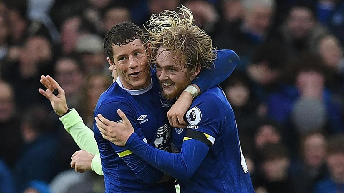 Everton's English midfielder Tom Davies (R) celebrates with Everton's English midfielder Ross Barkley after scoring their third goal during the English Premier League football match between Everton and Manchester City at Goodison Park in Liverpool, north-