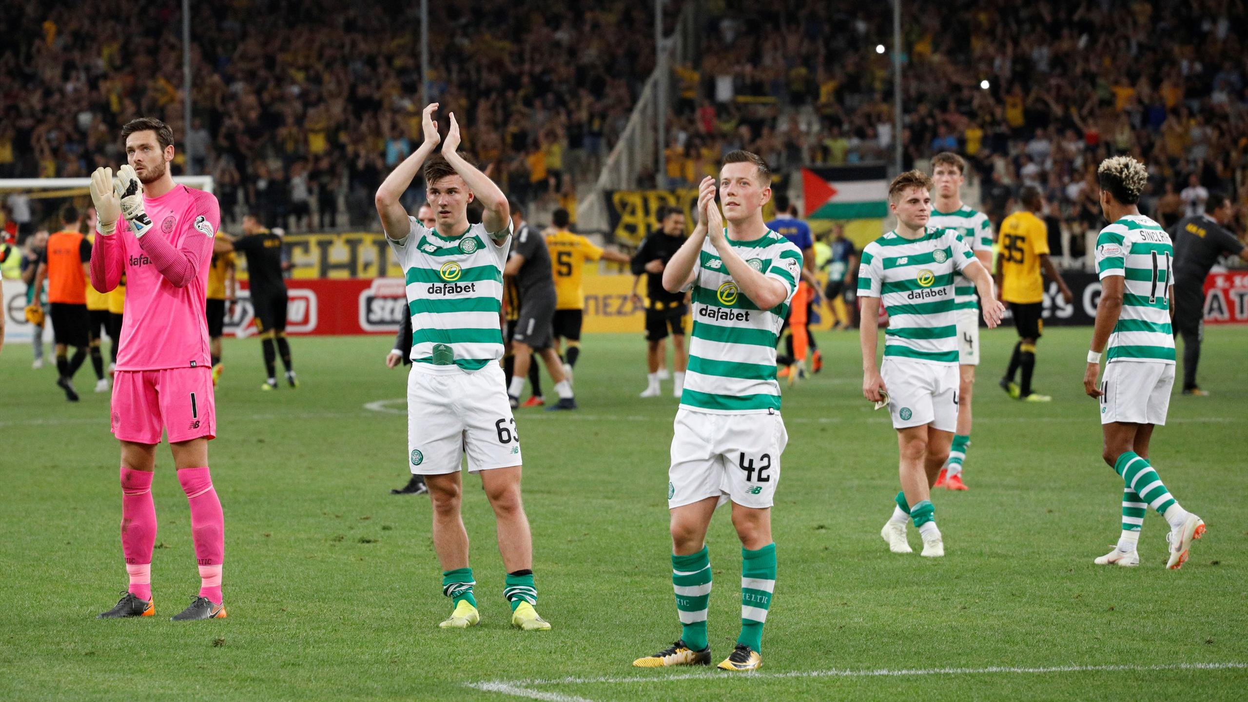 Celtic's Callum McGregor and team mates applaud fans after the match
