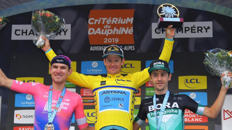 Emanuel Buchmann (Bora-Hansgrohe) and Tejay Van Garderen (EF Education-First) surround Jakob Fuglsang (Astana) on the podium of the Dauphiné 2019