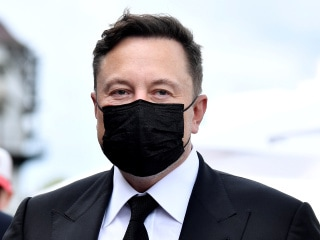 elon musk masked reuters small 1606893934458