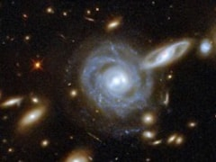 Nasa S Hubble Telescope Captures Image Of Galaxy Cluster 3 5 Billion Light Years Away Technology News