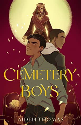 Top 10 Tuesday selection.  Cemetery Boys is written in yellow text. Two boys at the center, while a ghostly figure in a cloak stands in front of a full moon.