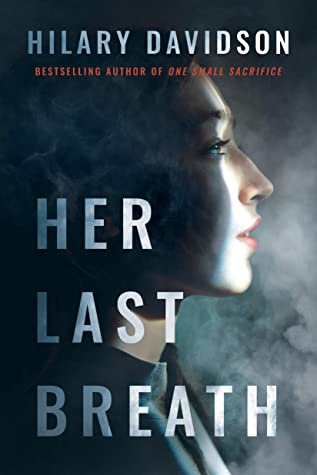 Book cover for Her Last Breath by Hilary Davidson, showing a face half in dark and half in light with smoky background
