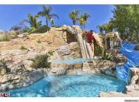 6 Epic Water Slides That Make A Lavish Swimming Pool Even