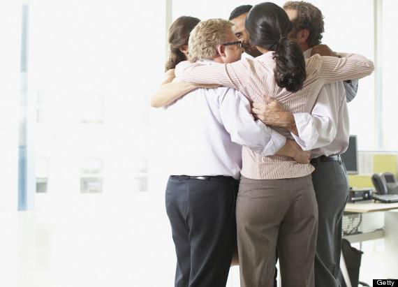 coworkers hugging