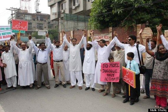 men holding up hands