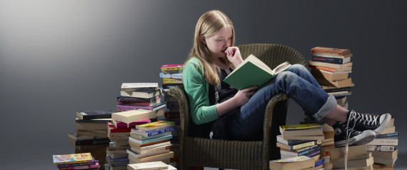 reading pile of books
