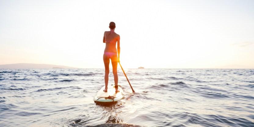 woman paddling in ocean