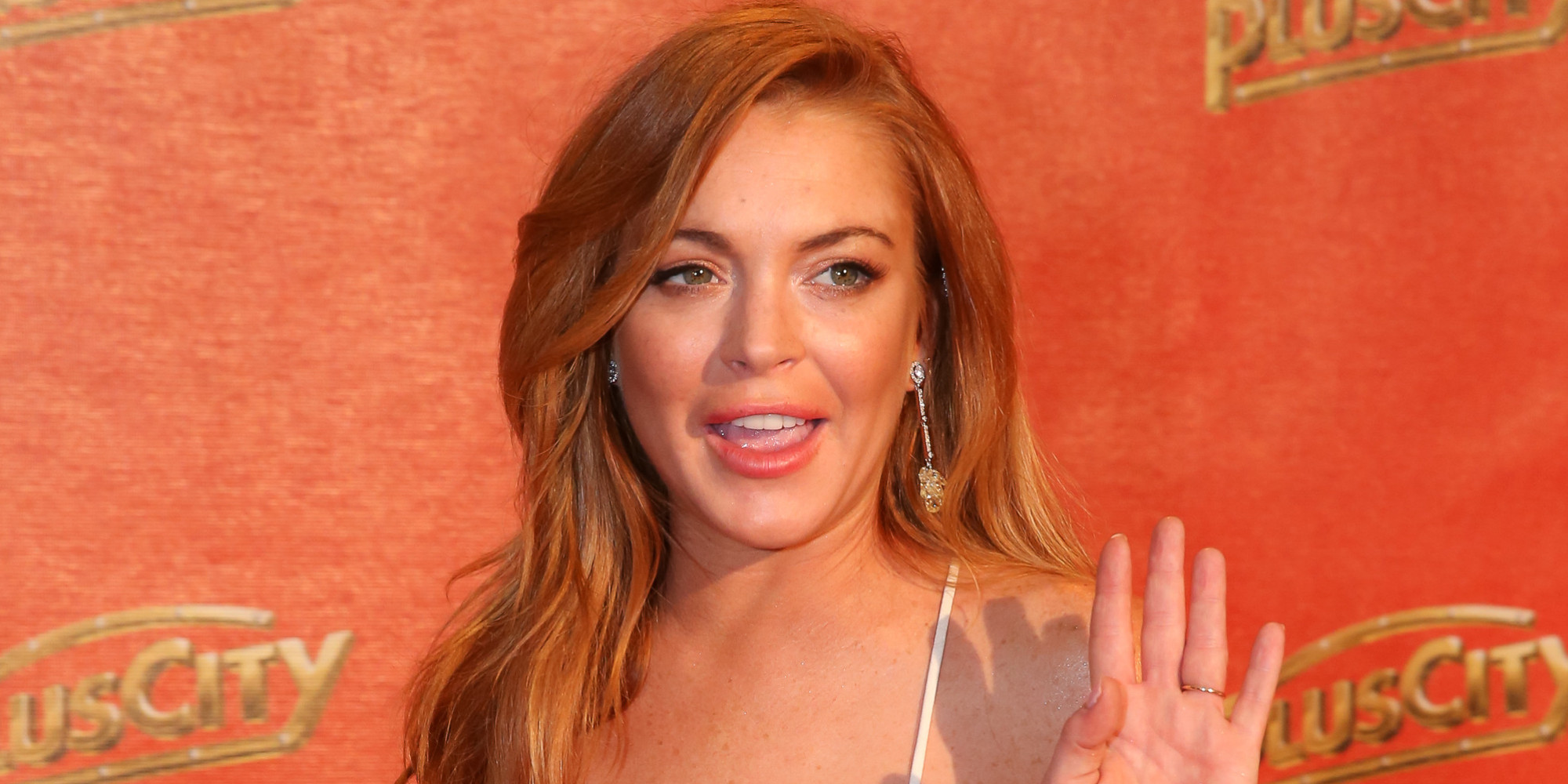 Lindsay Lohan Uploads Bikini Selfie In PoorlyLit Hotel