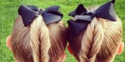 twin girls' intricate braided hairstyles