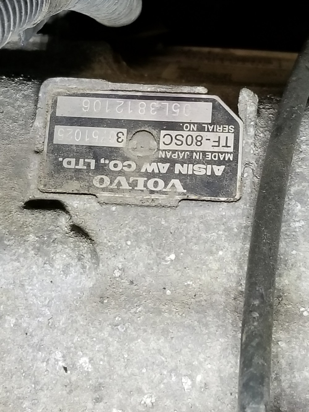 medium resolution of there s a similar metal tag on top of the transmission of the v8 s here s a photo which shows the location it s taken while standing next to the driver s