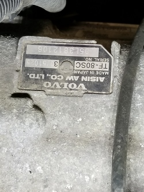 small resolution of there s a similar metal tag on top of the transmission of the v8 s here s a photo which shows the location it s taken while standing next to the driver s