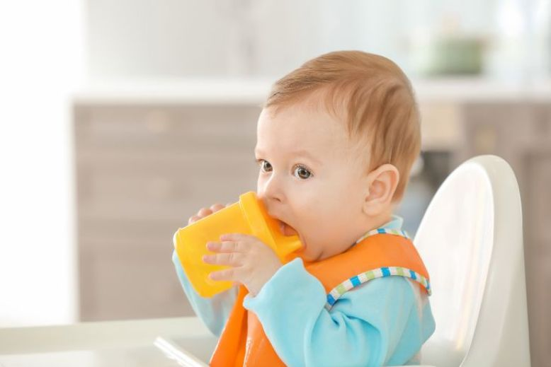 Using A Cup, how to teach baby to eat, how to teach baby to eat from spoon, how to teach baby to eat solids, teach baby to eat, teach baby to eat with spoon