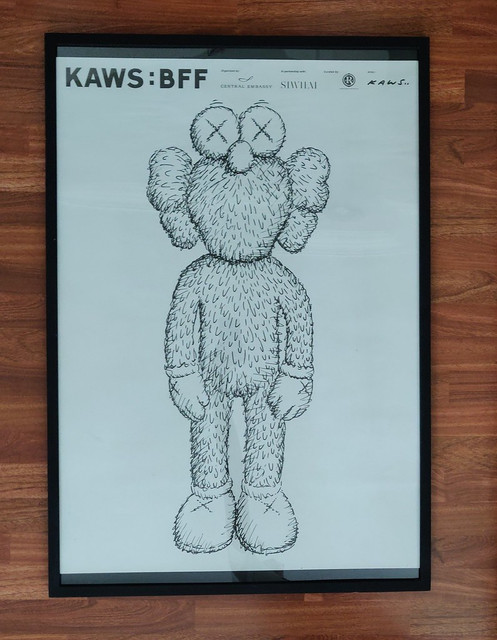 signed kaws poster showcard and javier