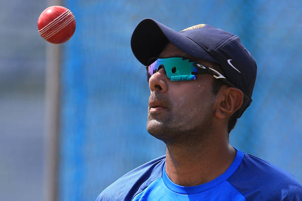 Indian-cricketer-Ravichandran-Ashwin-tosses-the-ball-during-a-practice-session-ahead-of-the-1st-test
