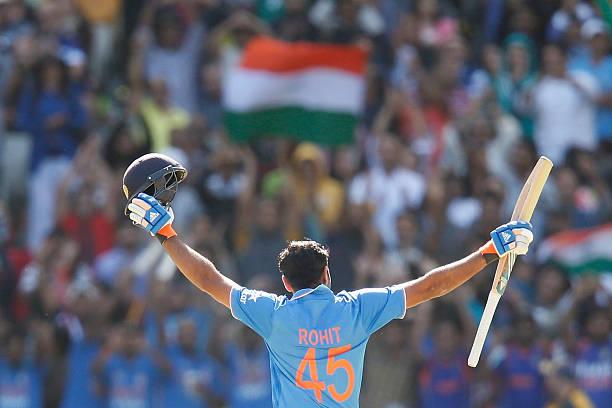 Rohit-Sharma-of-India-raises-his-bat-after-scoring-100-runs-during-th