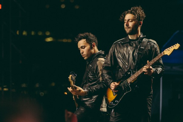 Pete Wentz and Joe Trohman of Fall Out Boy performing