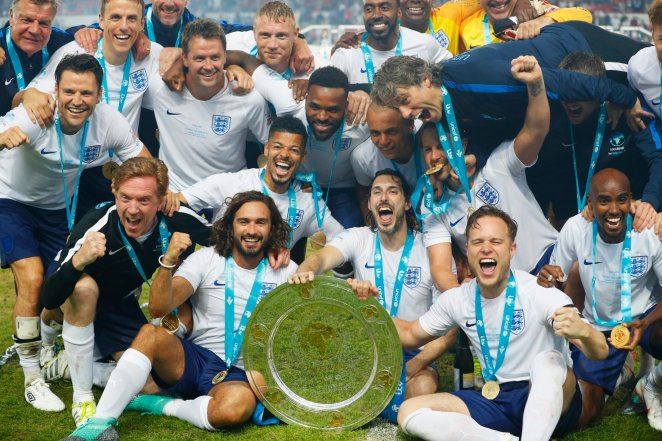 MANCHESTER, ENGLAND - JUNE 10: England players celebrate victory with the trophy after the Soccer Aid for UNICEF 2018 match between Englannd and the Rest of the World at Old Trafford on June 10, 2018 in Manchester, England. (Photo by Lynne Cameron/Getty Images)