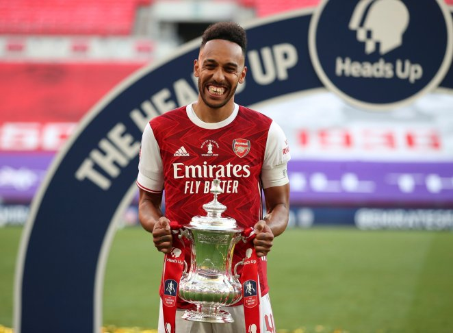 FILE - In this Saturday, Aug. 1, 2020 file photo, Arsenal's Pierre-Emerick Aubameyang celebrates with the trophy after the FA Cup final soccer match against Chelsea at Wembley stadium in London, England. Arsenal may have ended the season as FA Cup winners but their eighth-placed finish was their lowest in the Premier League since 1995 and head coach Mikel Arteta will have to steer his side through some tough early fixtures to give them a better chance of sealing a return to the top four. (Adam Davy/Pool via AP, file)
