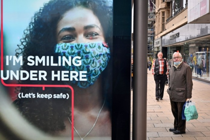 EDINBURGH, SCOTLAND - SEPTEMBER 14: Members of the public march through the city center as a new law comes into force limiting social gatherings to a maximum of six people from two households on September 14, 2020 in Edinburgh, Scotland. The country has joined with England in putting a six-person limit on indoor and outdoor gatherings to curb the increase in Covid-19 infections. (Photo by Jeff J Mitchell / Getty Images)