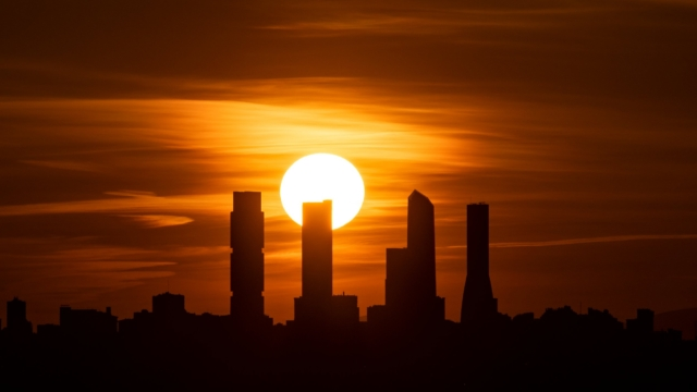 MADRID, SPAIN - 2021/02/27: The sun sets behind the skyline with the Four Towers Business Area (CTBA) during a spring afternoon with warm weather. (Photo by Marcos del Mazo/LightRocket via Getty Images)
