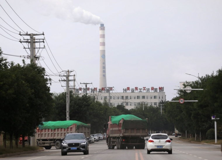 FILE PHOTO: A chimney of a China Energy coal-fired power plant is pictured in Shenyang, Liaoning province, China September 29, 2021. REUTERS/Tingshu Wang/File Photo