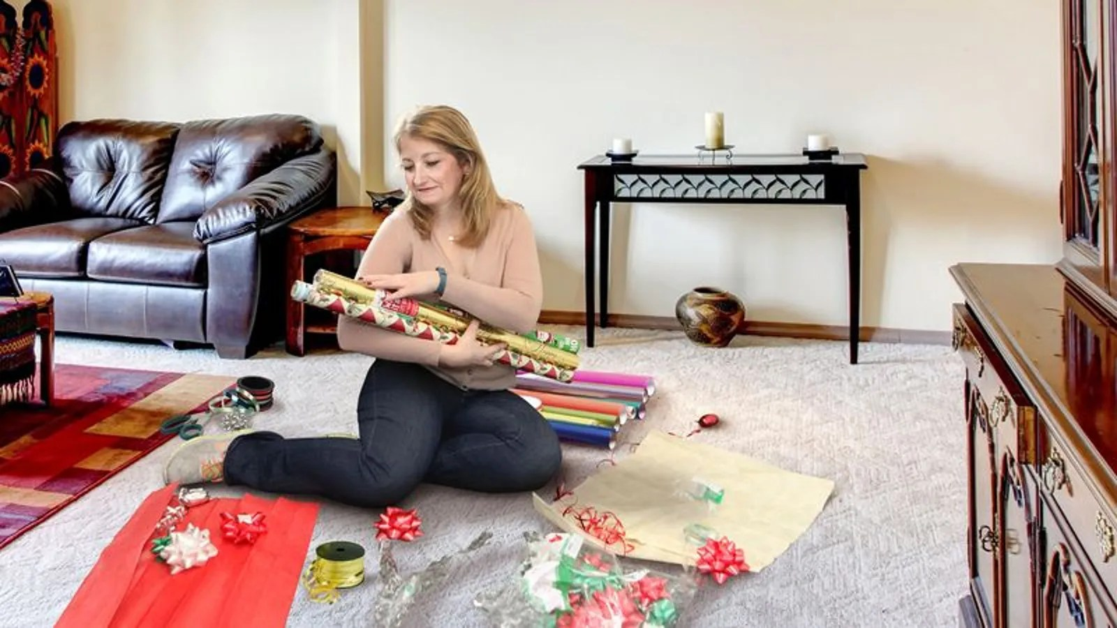 Mom Gathers Rolls Of Wrapping Paper Around Her To Stroke