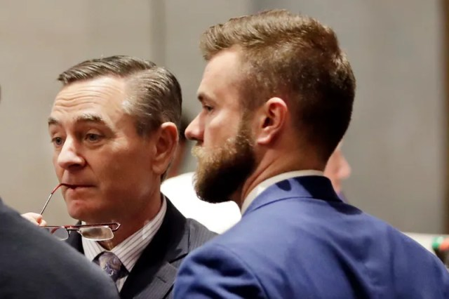 House Speaker Glen Casada, R-Franklin, left, talks with Cade Cothren, right, his chief of staff, during a House session in Nashville, Tenn. Cothren has resigned amid allegations of racist and sexually explicit texts.