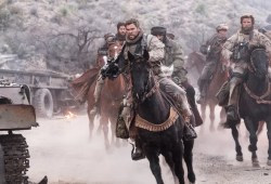Chris Hemsworth takes on the Taliban in 12 Robust, a struggle film that's extra ho-hum than gung ho