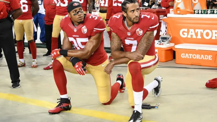 Eric Reid, No. 35, and Colin Kaepernick, No. 7, of the San Francisco 49ers kneel in protest during the national anthem prior to playing the Los Angeles Rams at Levi's Stadium on Sept. 12, 2016, in Santa Clara, Calif. (Thearon W. Henderson/Getty Images)
