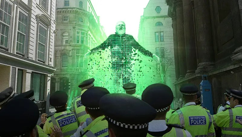 Illustration for article titled Cackling Julian Assange Disintegrates Into Lines Of Code As Baffled Authorities Attempt To Handcuff Him