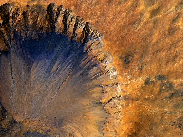 We're Keeping A Close Eye On This Hole Punched In The Surface Of Mars