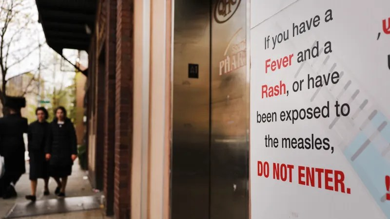 A sign warns people of measles in the ultra-Orthodox Jewish community in Williamsburg on April 19, 2019 in New York City.