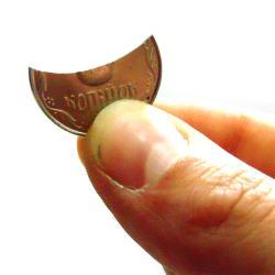Фокус «Отламывание монеты»