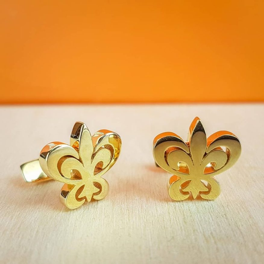 3D-printed cufflinks in the shape of a fleur de lis