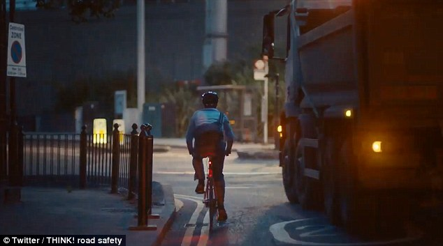 The 45-second advert 'Things you shouldn't get caught between' shows a lorry overtake a cyclist at a junction (pictured)