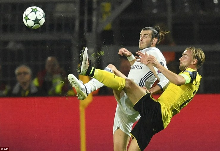 Wales starGareth Bale gets physical with Dortmund defenderMarcel Schmelzer as the visitors take an early lead