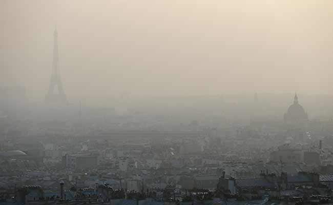 Image result for Eiffel Tower in smog