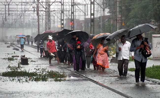 As Rain Stops Water Recedes From Mumbai Roads Train Services Resume