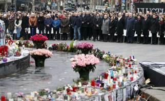 Image result for France pays homage to victims of militant attacks