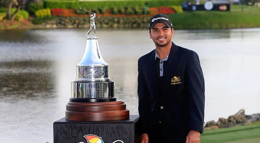 Jason Day poses with the trophy following the final round of the Arnold Palmer Invitational. (Chris Trotman/Getty Images)