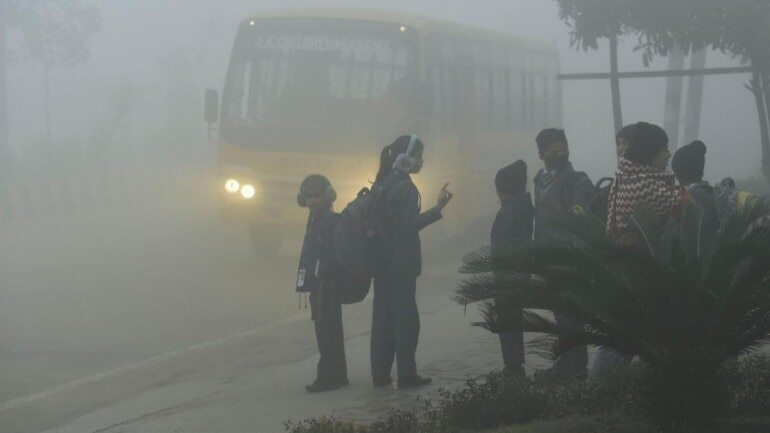 https://i.postimg.cc/287LtfjP/Students-in-warm-clothing-wait-for-their-transport-vehicle- image source: PTI
