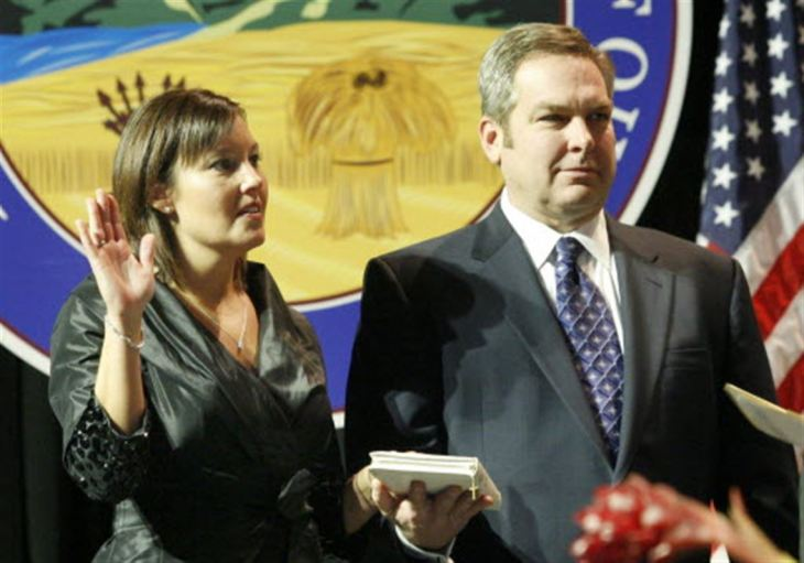 Mary Taylor taking the oath with her husband Don Taylor