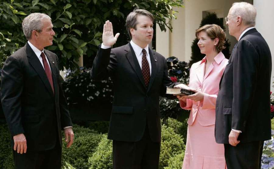 Kavanaugh being sworn in by Justice Anthony Kennedy as President George W. Bush and Kavanaugh's wife, Ashley Estes Kavanaugh, look on