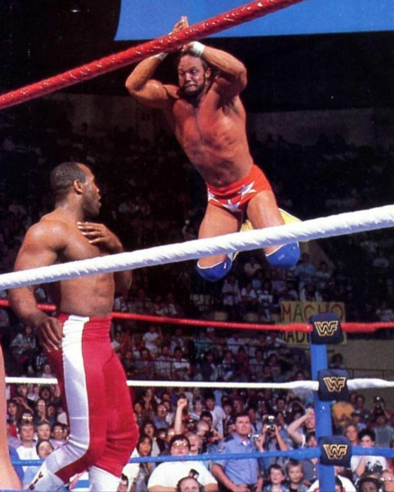 Picture of Randy Macho Man Savage Delivering Top Rope Double Ax Smash to  Virgil ('88) : SquaredCircle
