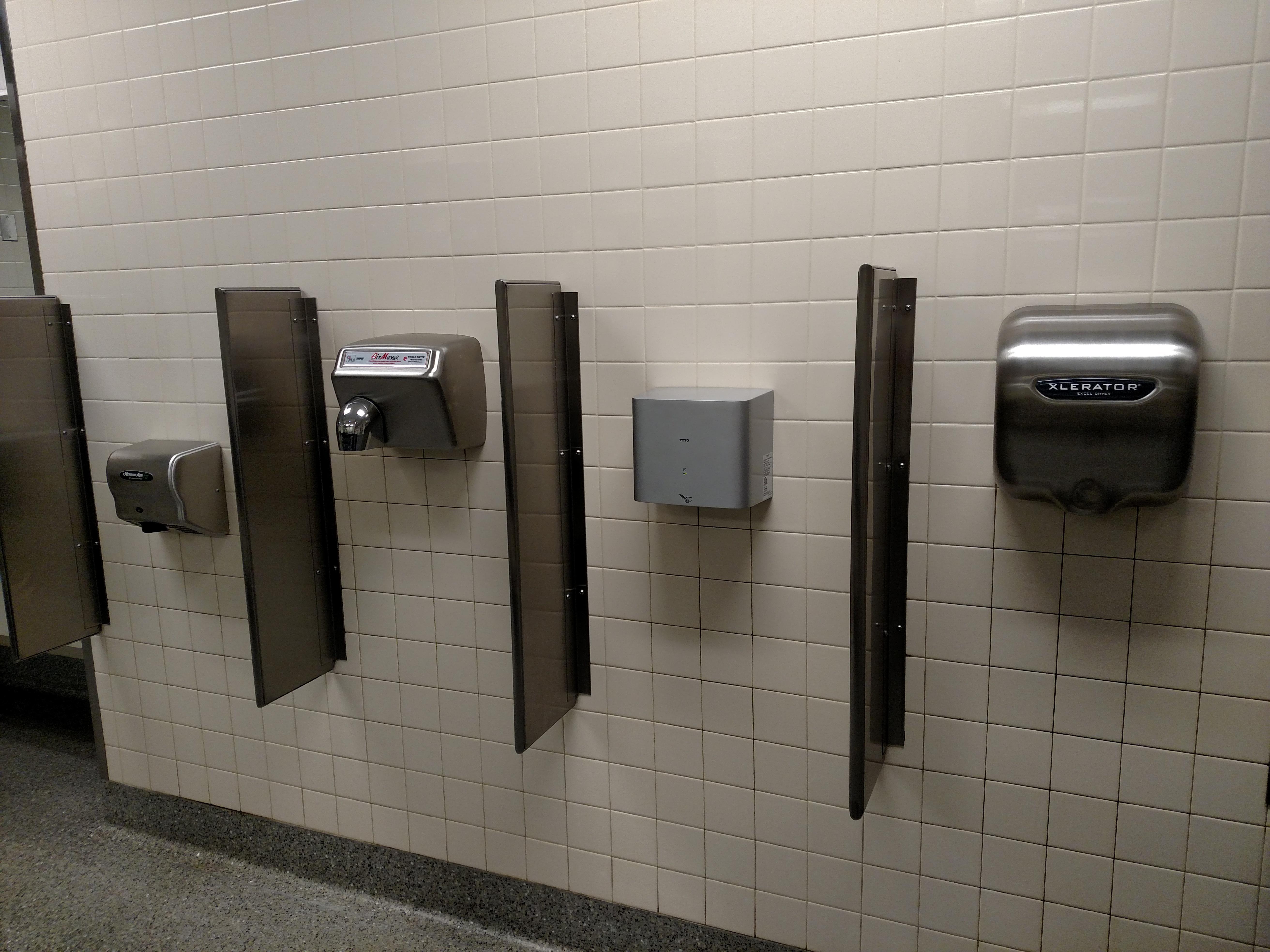 Bathroom has a choice of hand dryers  Rebrncom