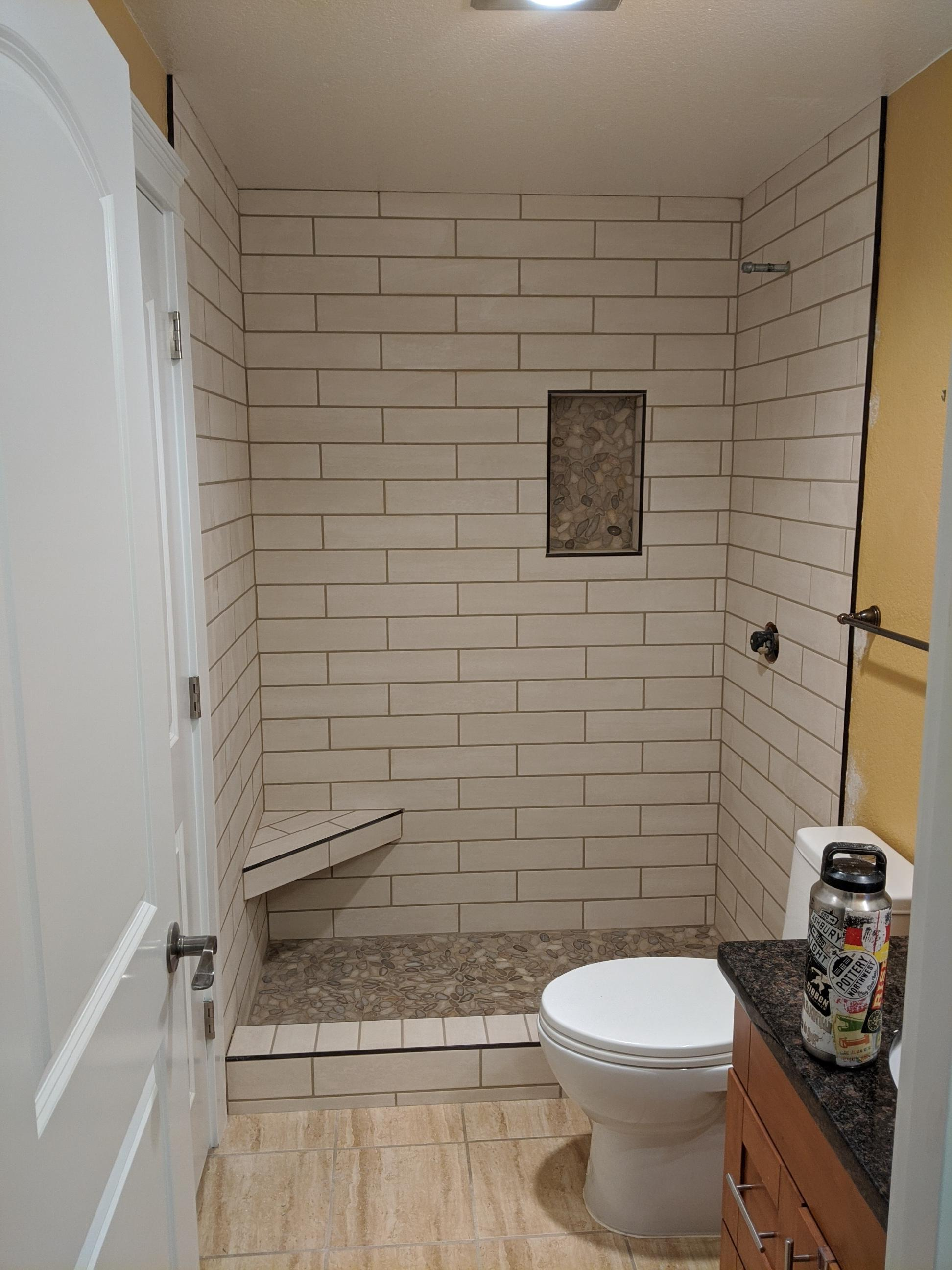 4x16 wall tile with river stone niche