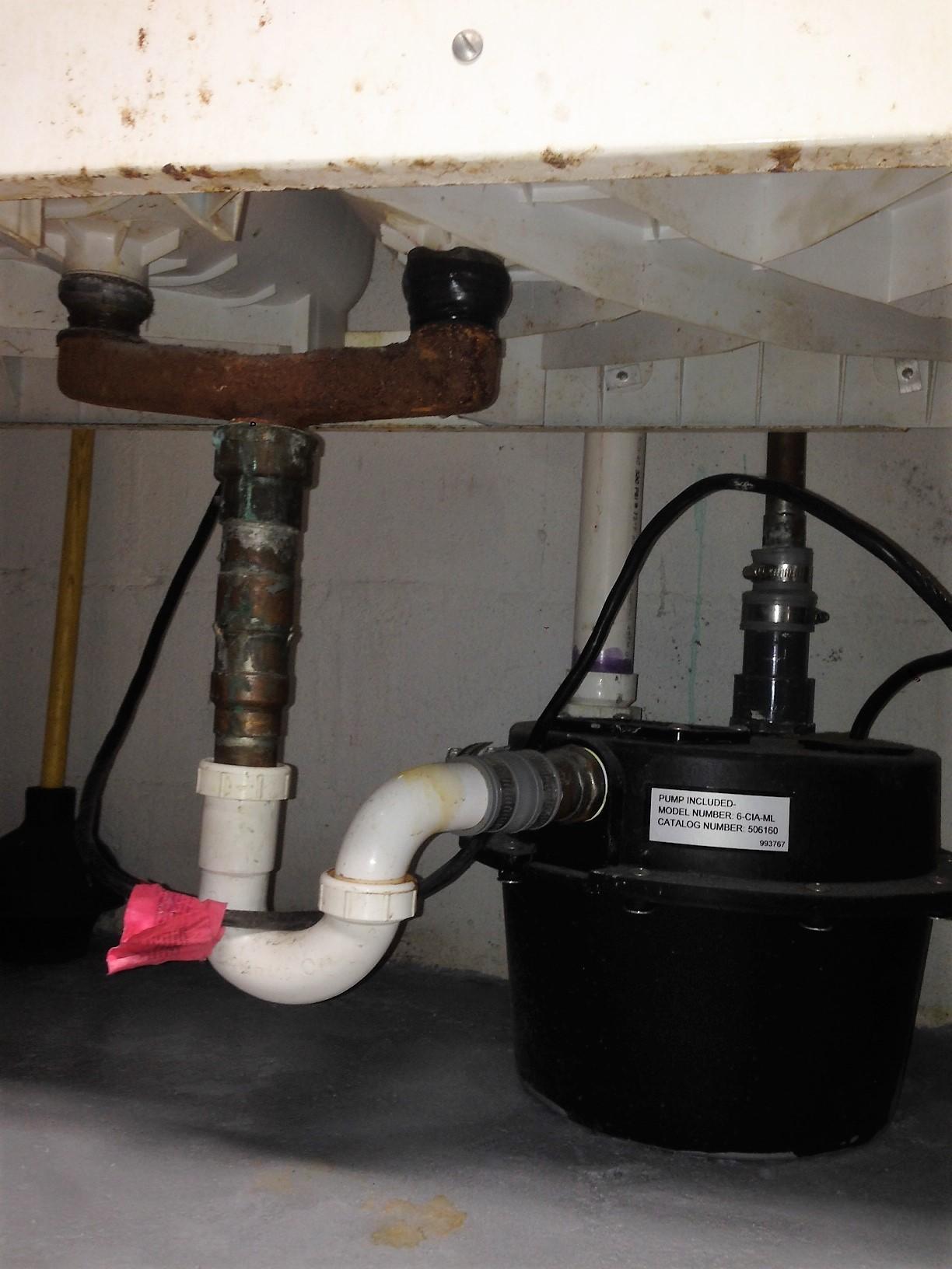 pump beneath basement utility sink