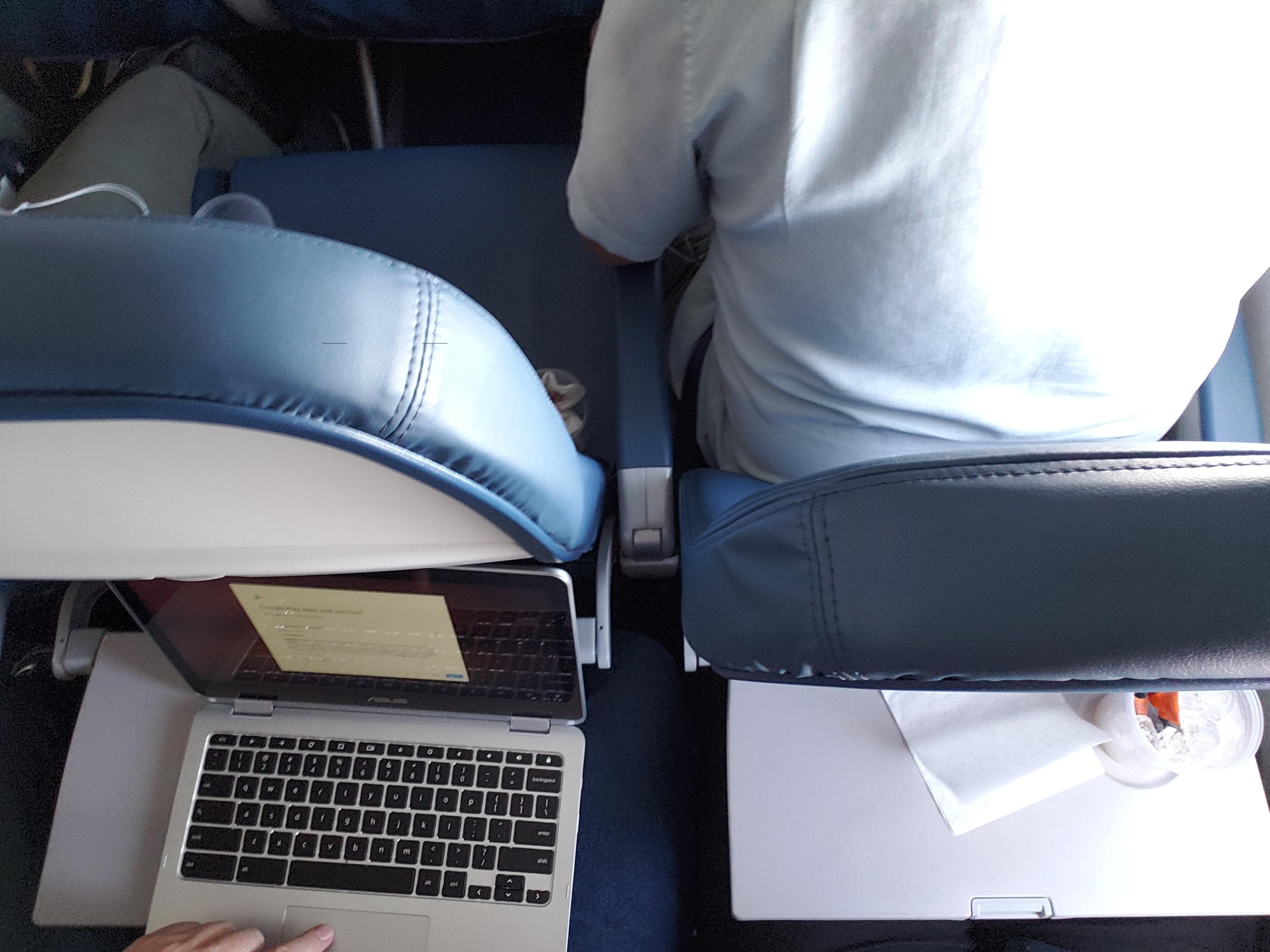 desk chair leans forward tattoo chairs reclining your seat back on the plane but leaning whole mildlyinfuriating